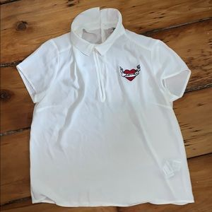 "White collared shirt with ""love"" patch."